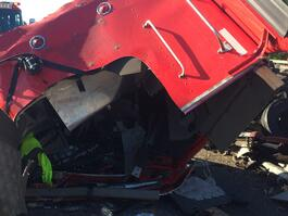 wrecked cab of Lightner's overturned semi at accident on I-75 and Newberry Road exit