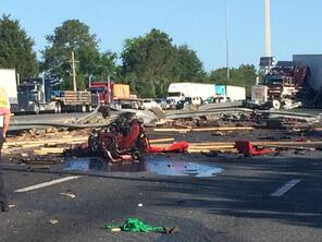 leaked fuel from accident pooling on I-75 in Gainesville